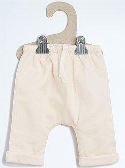 Calças em tecido forrado