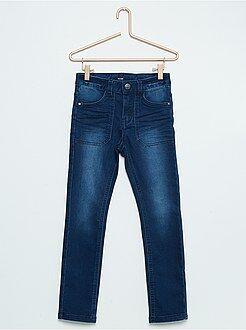Calças skinny fit em algodão elástico