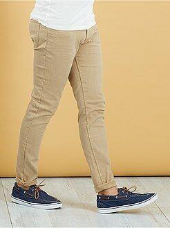 Calças - Calças slim com 5 bolsos em algodão elástico