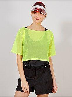 Mulher Crop top em malha de rede fluorescente
